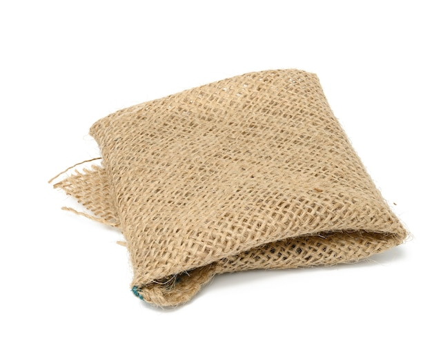 Folded brown burlap fabric and ioled on white background
