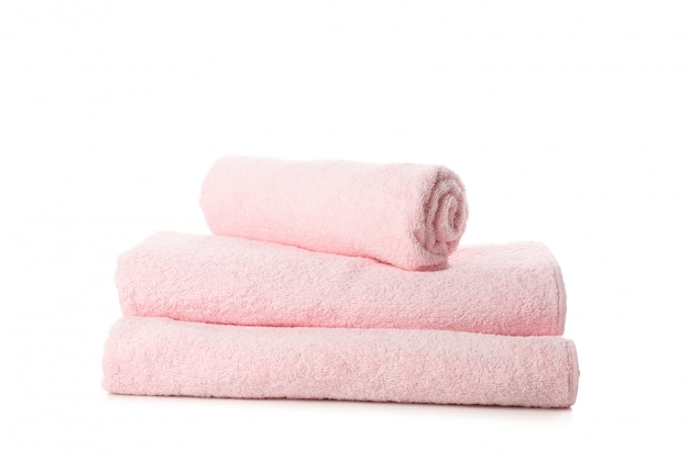 Folded fresh pink towels isolated on white