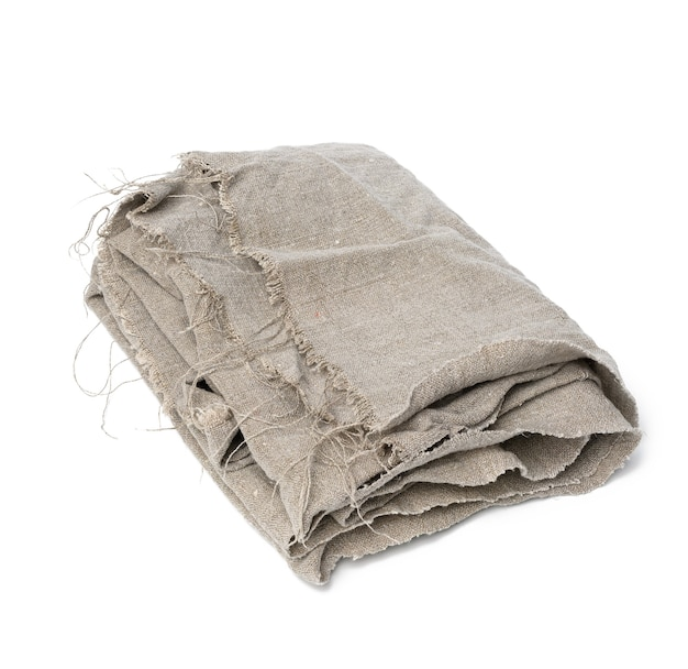 Folded kitchen gray linen tea towel isolated on white background, close up