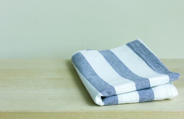 Folded napkin on wooden table
