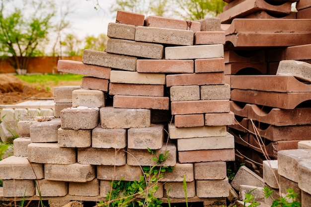 Folded paving slabs, paving stones and bricks. construction, repair and improvement of roads.