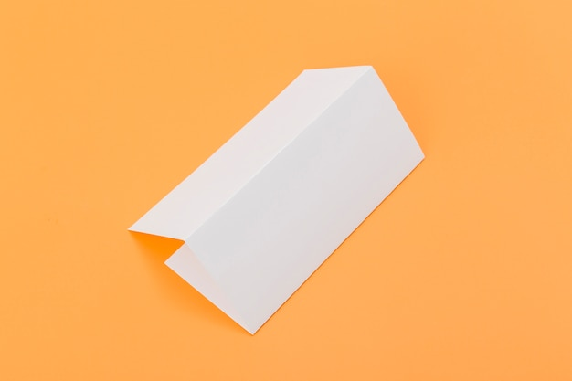 Folded rectangle brochure on desk