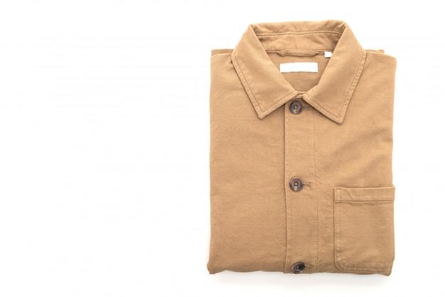 Сложенная рубашка на белом