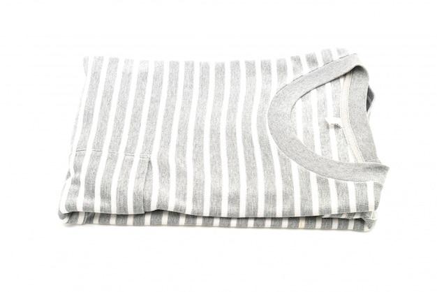 Сложенная полосатая футболка на белом