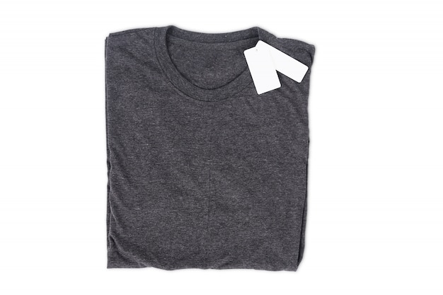 Folded t-shirt with tag isolate on white background with clipping path for design mockup