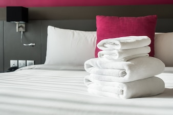 Folded towels on the bed