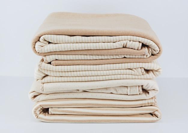 Folded up natural cotton blanket