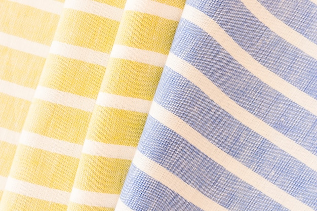 Folded yellow and blue fabric linen