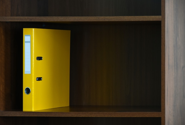 Folder file is on the shelf in the cabinet