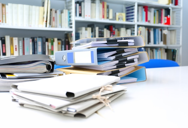 Folders with documents on table in archive