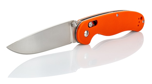 Folding pocket knife with open matte blade and textured bright orange composite plastic cover plates on steel handle isolated on white background