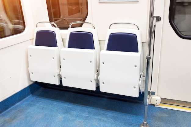Folding seats in public passenger transport, interior
