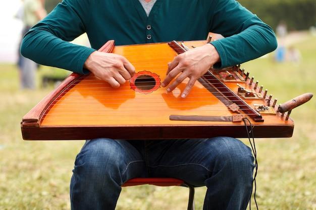 Folk musician playing gusli