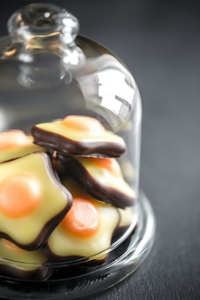 Fondant candies under the glass dome