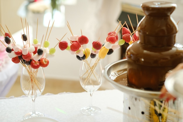 Fondue with a chocolate fountain and sweets for it.sweet theme