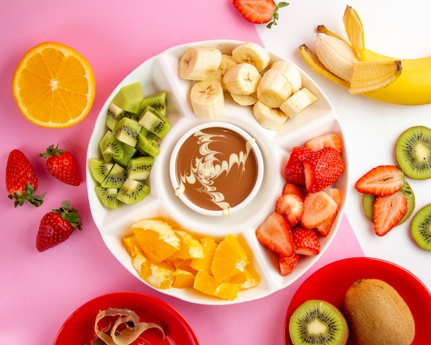 Fondue with chocolate kiwi banana strawberry and orange