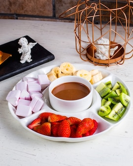 Fondue with fruits on the table