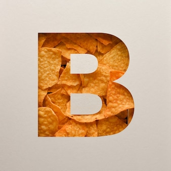 Font design, abstract alphabet font with triangle corn chips, realistic leaves typography - b