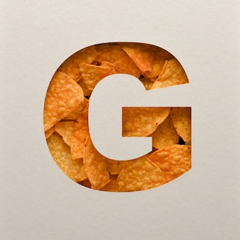 Font design, abstract alphabet font with triangle corn chips, realistic leaves typography - g