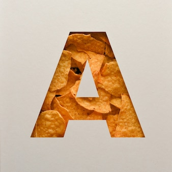 Font design, abstract alphabet font with triangle corn chips, realistic leaves typography - a