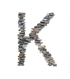 Font of k to create from stone wall isolated on white.