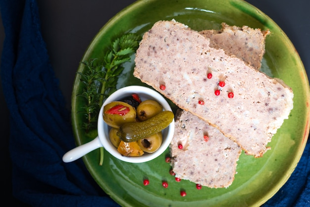 Food appertiser concept french meatloaf terrine or pate in green dish