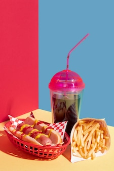 Food arrangement with hot dog and juice cup
