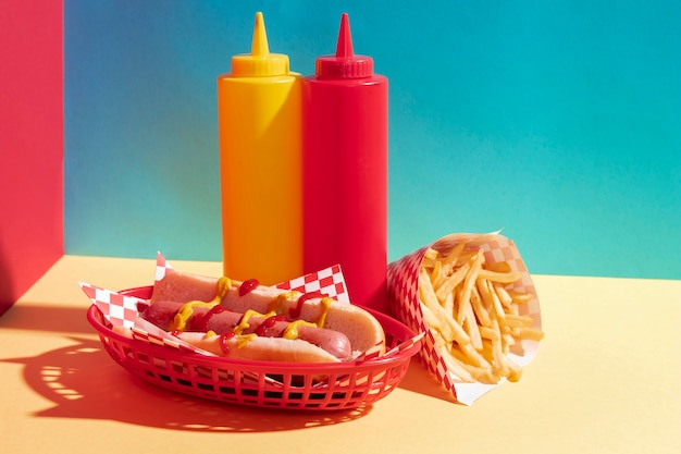 Food assortment with hot dog and sauce bottles