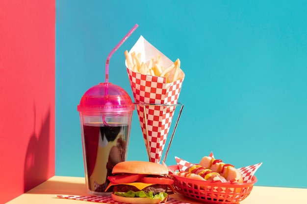 Food assortment with juice cup and cheeseburger