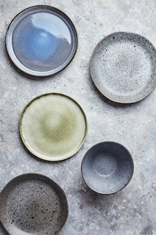 Food background empty plates on grey background top view flatlay copyspace