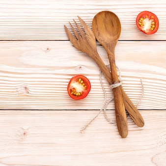 Food background and salad concept with raw ingredients  flat lay on white wooden background.