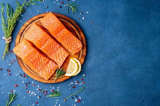 Food background, sliced portions large salmon fillet steaks