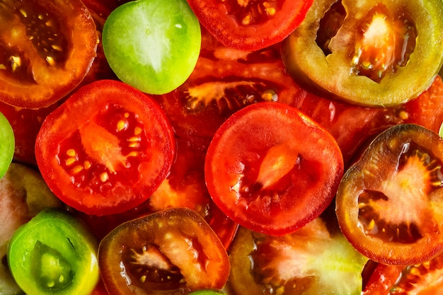 Food background of sliced red, green and kumato tomatoes