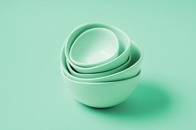 Food background with empty plates, over neo mint color background, flat lay.
