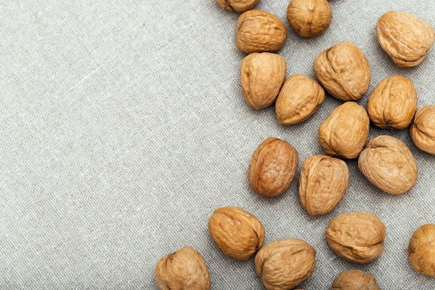 Food background with nuts on cloth and copy space.