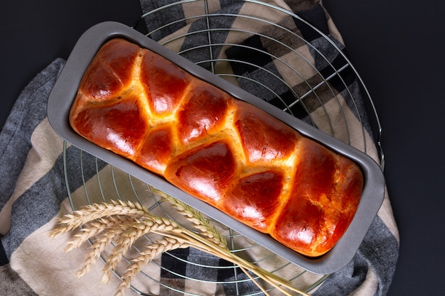 Food bakery concept fresh baked brioche braided bread loaf with copy space