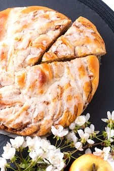 Food bakery concept fresh baked homemade apple cinnamon roll braided bread with copy space