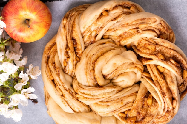 Food bakery concept making bread dought for apple cinnamon roll braided bread with copy space