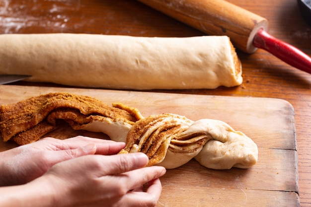 Food bakery concept making bread dought for cinnamon roll braided bread with copy space
