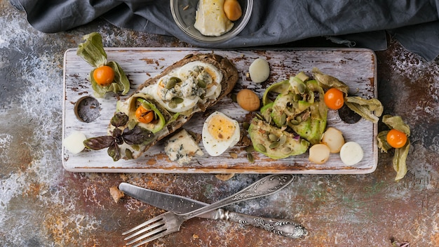Food banner. appetizing sandwiches with cheese, egg, avocado and pumpkin seeds.