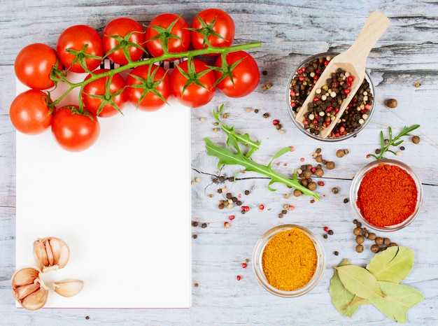 Food banner with cherry tomatoes, garlic, peppercorns, spice and notebook