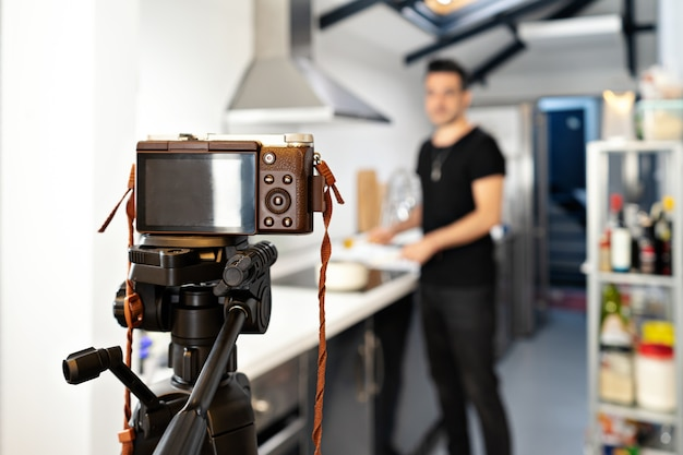 Food blogger recording tutorial online in front of camera