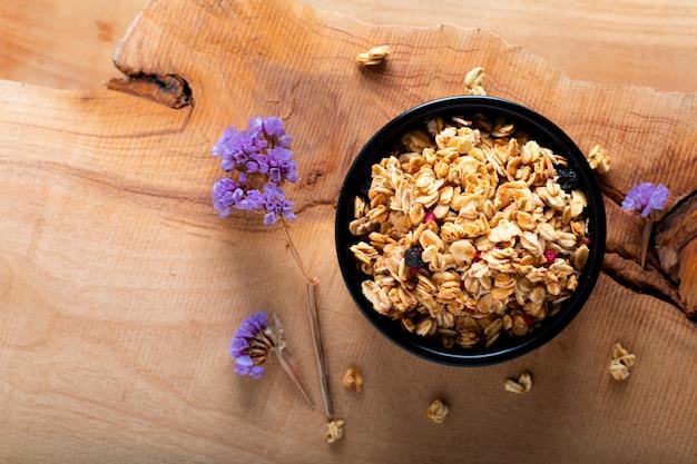 Food breakfast concept organic muesli or granola on black ceramic cup