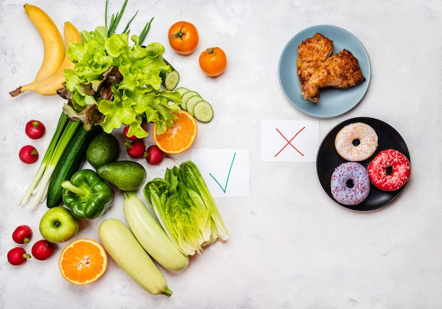 Food choise concept. junk food and diet healthy food. top view.