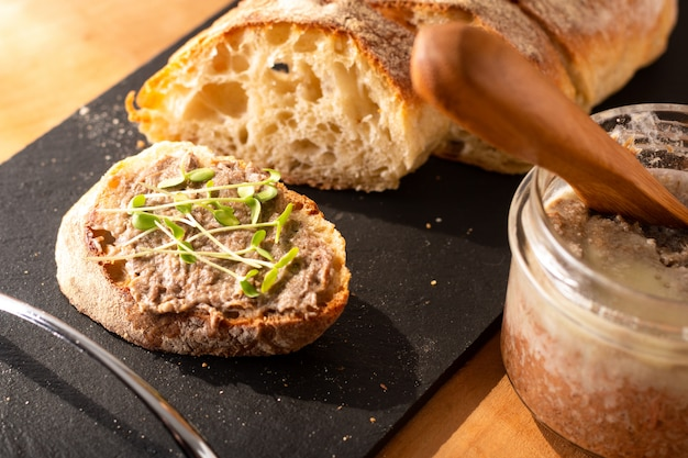 Food concept french beefs rillettes  spread on homemade crusty artisan ciabatta bread