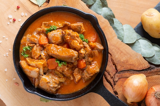 Food concept french classic veal stew marengo de veau in skillet iron cast with copy space