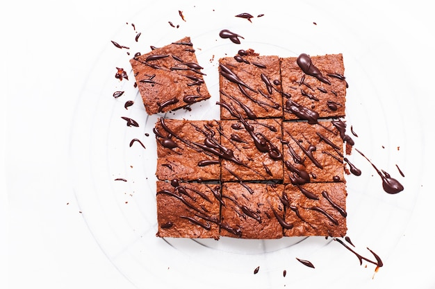Food concept homemade organic brownies on baking sheet with copy space
