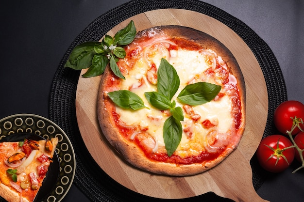 Food concept homemade tortilla margherita pizza on wood board