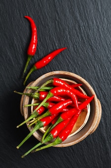 Food concept thai red chili, cayenne pepper on bamboo tray