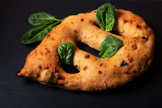 Food concept  traditoin french fougasse artisan flatbread on black slate board with copy space